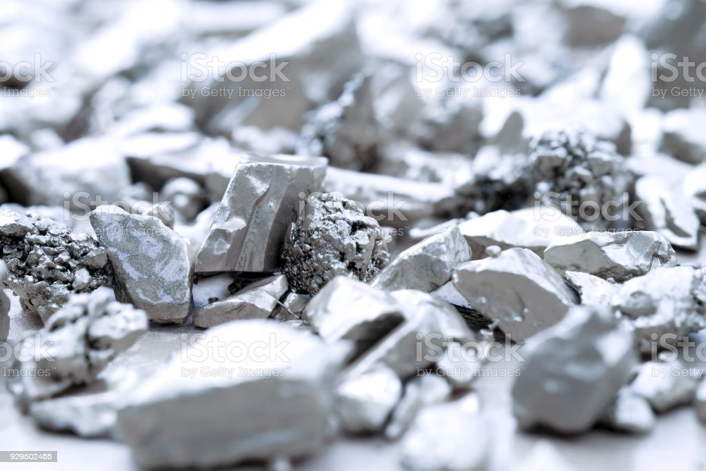 lump of silver or platinum on a stone floor stock photo