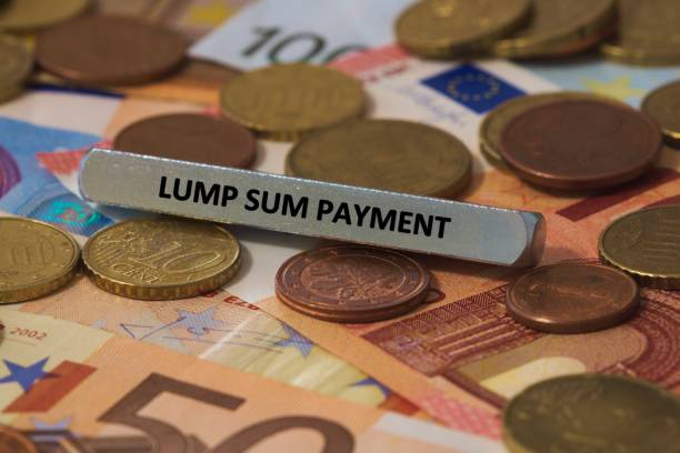 lump sum payment - the word was printed on a metal bar. the metal bar was placed on several banknotes stock photo
