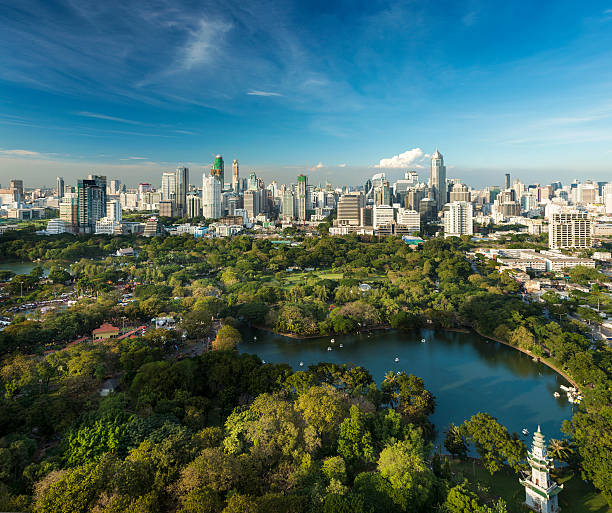 Lumphini Park and the downtown Bangkok City Skyline Thailand stock photo