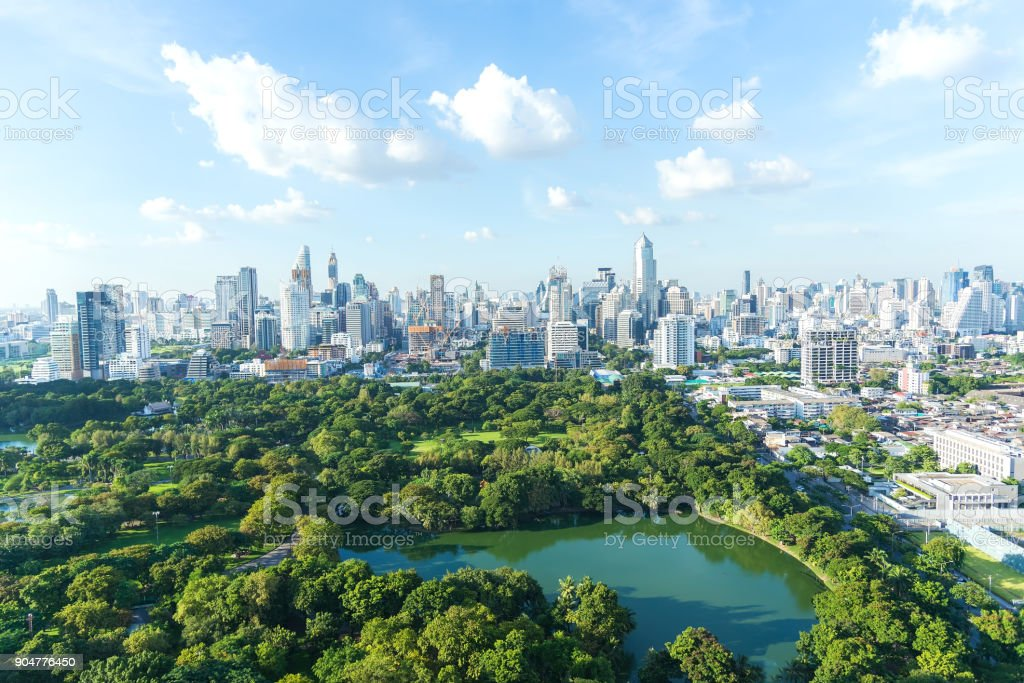 Lumpinee garden and Sathorn building in Bangkok, Thailand stock photo