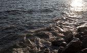 Big white sea wave with hexa-shape rocks