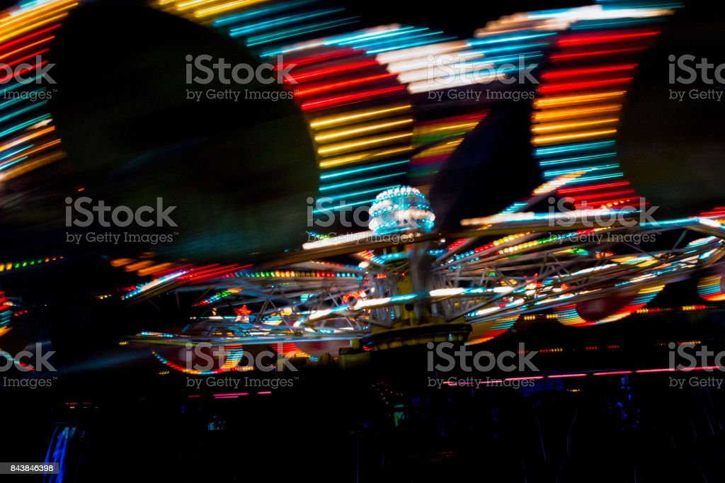 luna park attraction wheel  with lights in motion segment of circle stock photo
