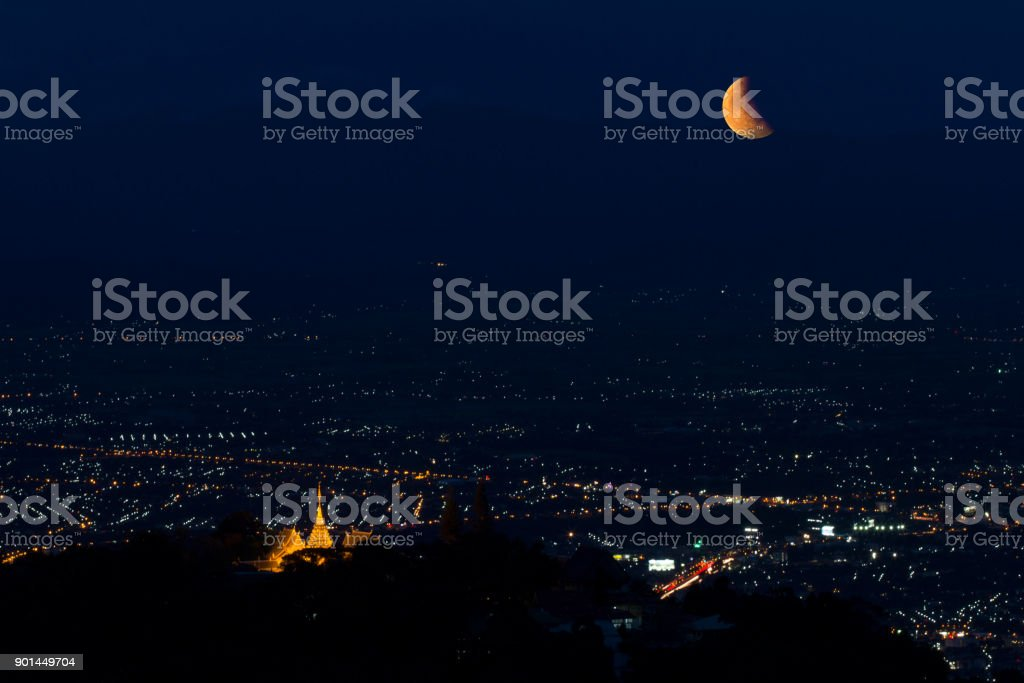 Lunar Eclipse over Chiangmai city in Thailand. stock photo