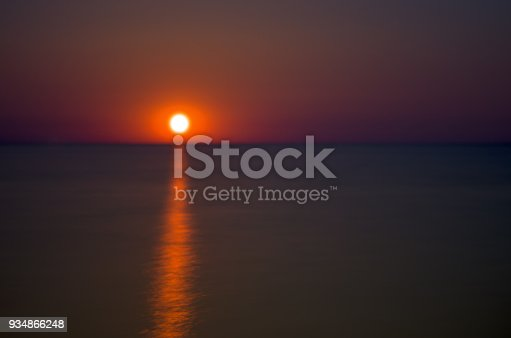 1039894076 istock photo lunar path of red color on the sea 934866248