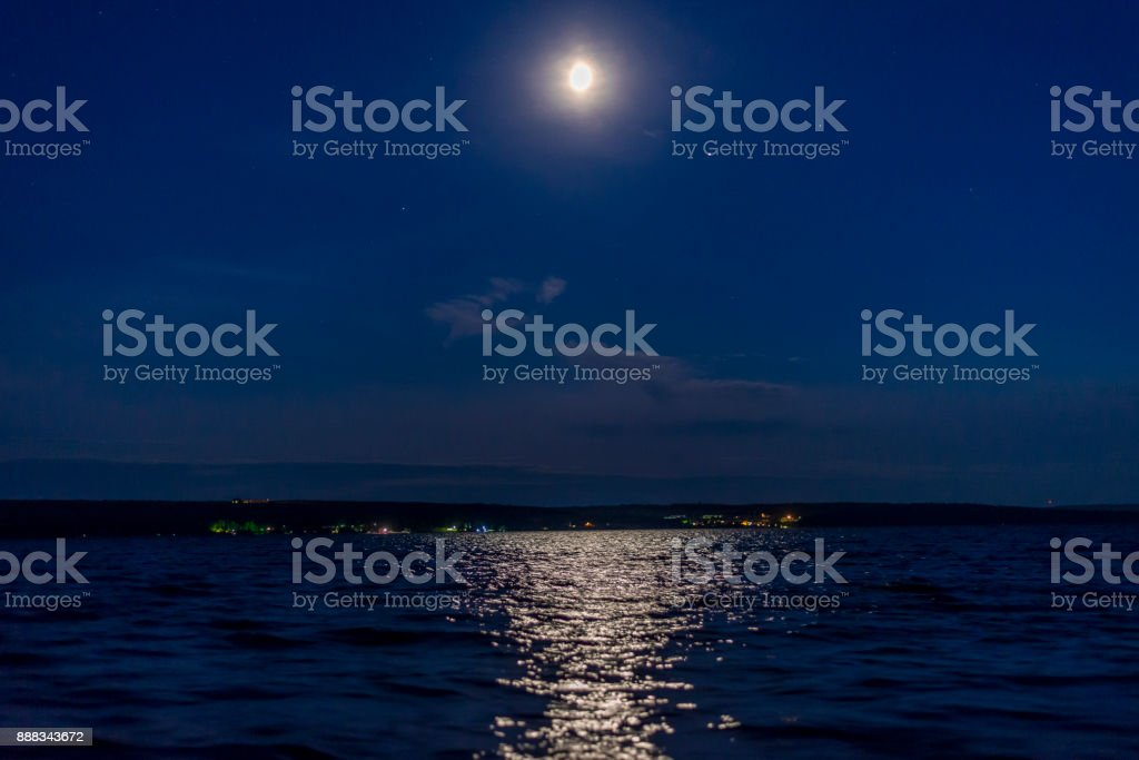Lunar sunset over the lake stock photo