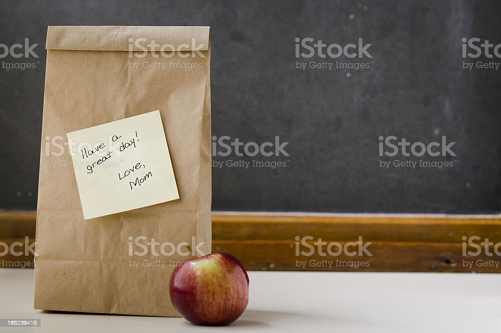 Lunch Bag with Note from Mom and Apple Horizontal royalty-free stock photo