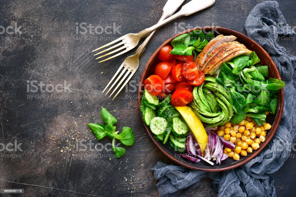 Lunch bowl with vegetables,beans and chicken meat