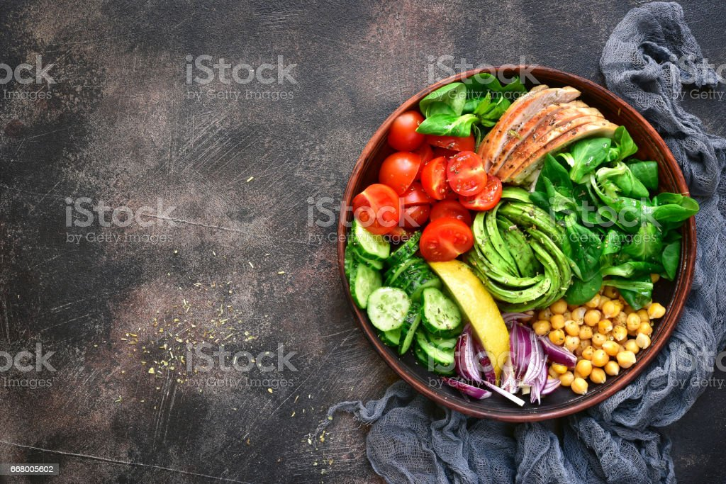 Lunch bowl with vegetables,beans and chicken meat stock photo