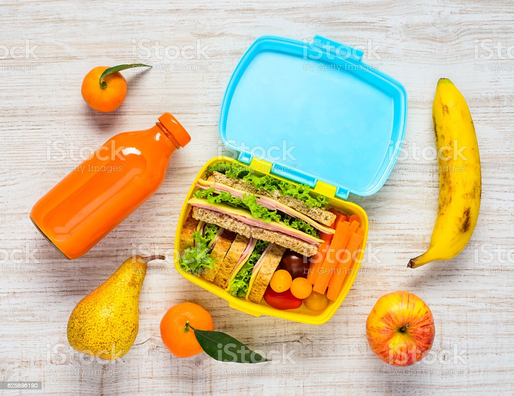 Lunch Box with Drinks, Sandwiches and Fruits stock photo