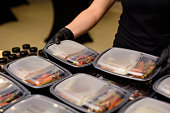 Lunch box with food in the hands. Catering