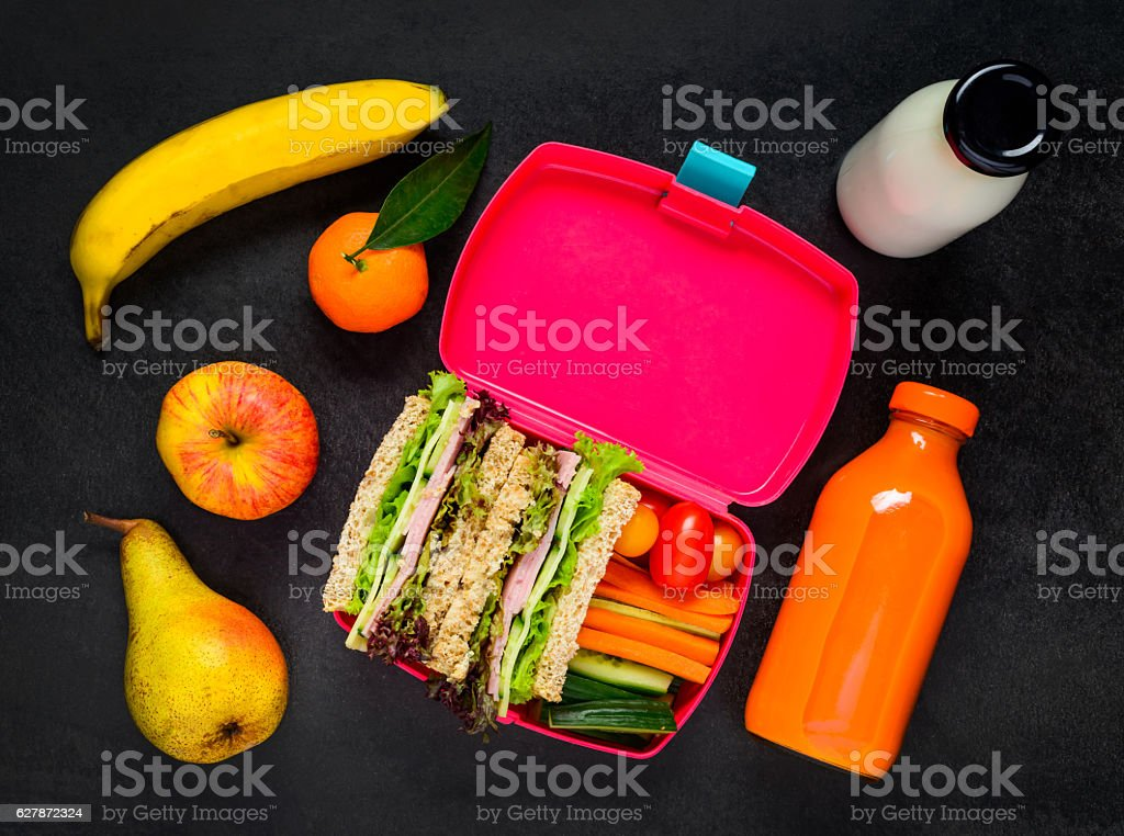 Lunch Box with Fruits, Drinks and Sandwich stock photo