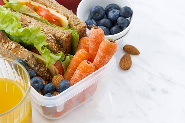lunch box with sandwich of wholemeal bread on white background - lunchrast bildbanksfoton och bilder