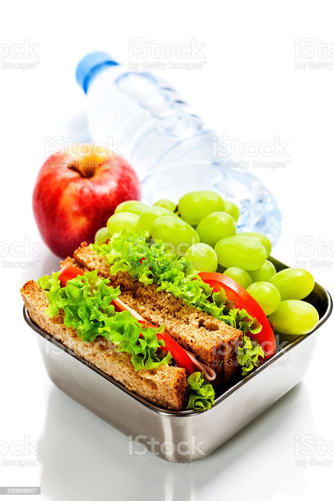 Lunch box with sandwiches and fruits stock photo