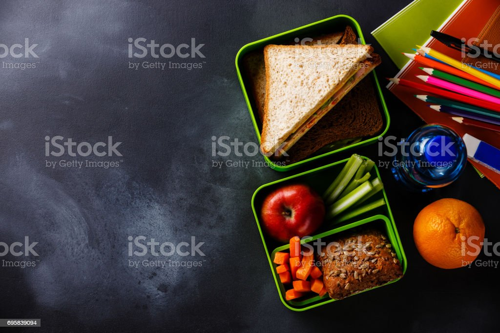 Lunch box with Sandwiches, bottle of water and school supplies stock photo