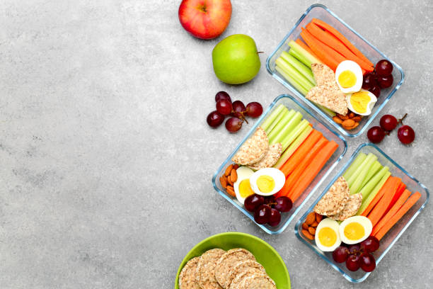 lunch boxes with healthy snacks, overhead view - healthy food imagens e fotografias de stock