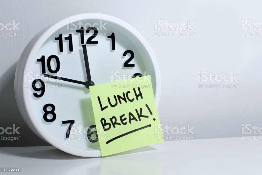Lunch break note on office clock stock photo