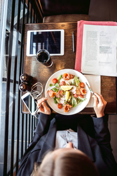 Lunch break on the go for a young businesswoman in downtown stock photo