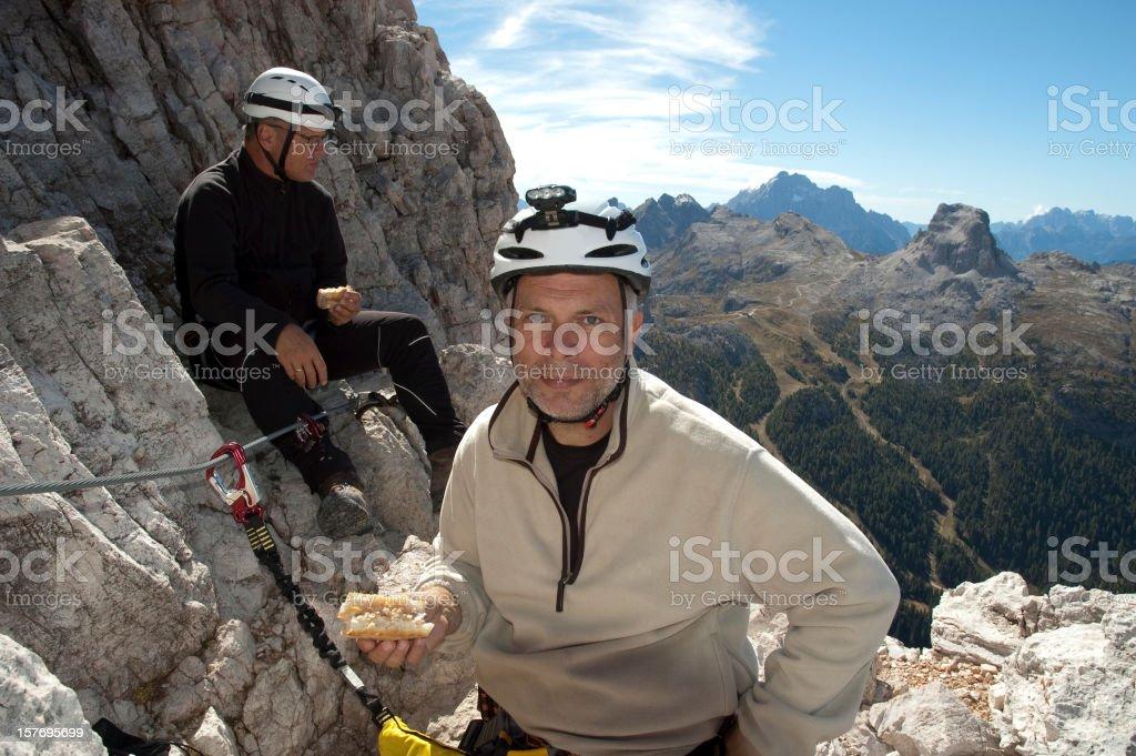 Lunch break on the via ferrata royalty-free stock photo