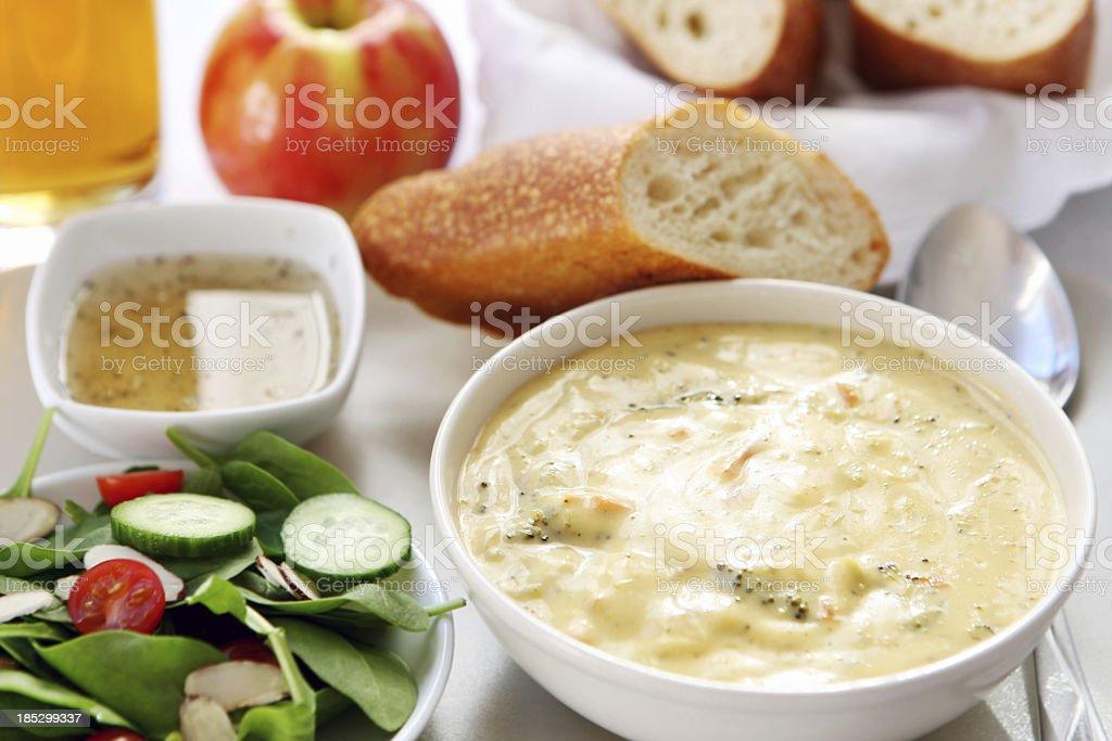 lunch - broccoli cheddar soup, bread,salad stock photo
