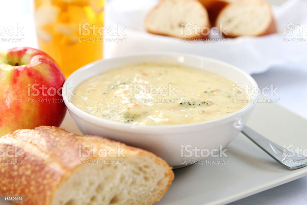 lunch - broccoli cheddar soup with bread, stock photo