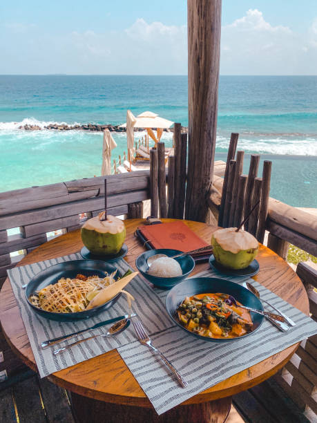 Lunch by the sea in Maldives stock photo