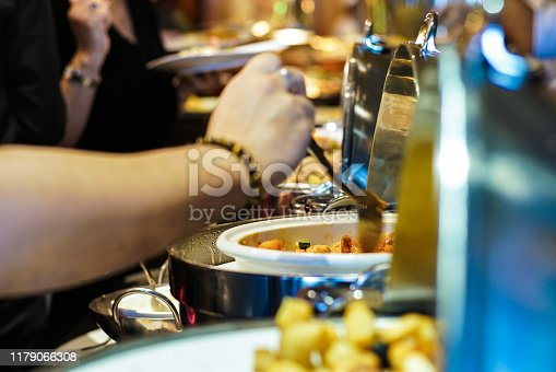 546450250istockphoto Lunch food buffet catering party with hand of people enjoying 1179066308