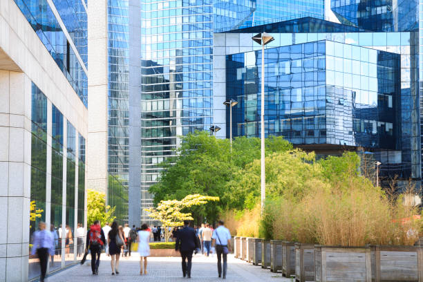 Lunch Hour Workout, Blurred Business People Walking in Financial District, La Defense, Paris, France stock photo