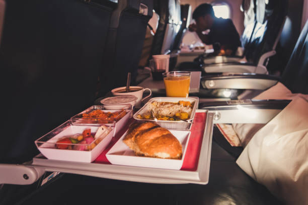 Lunch in airplane. Inflight economy class meal on tray stock photo