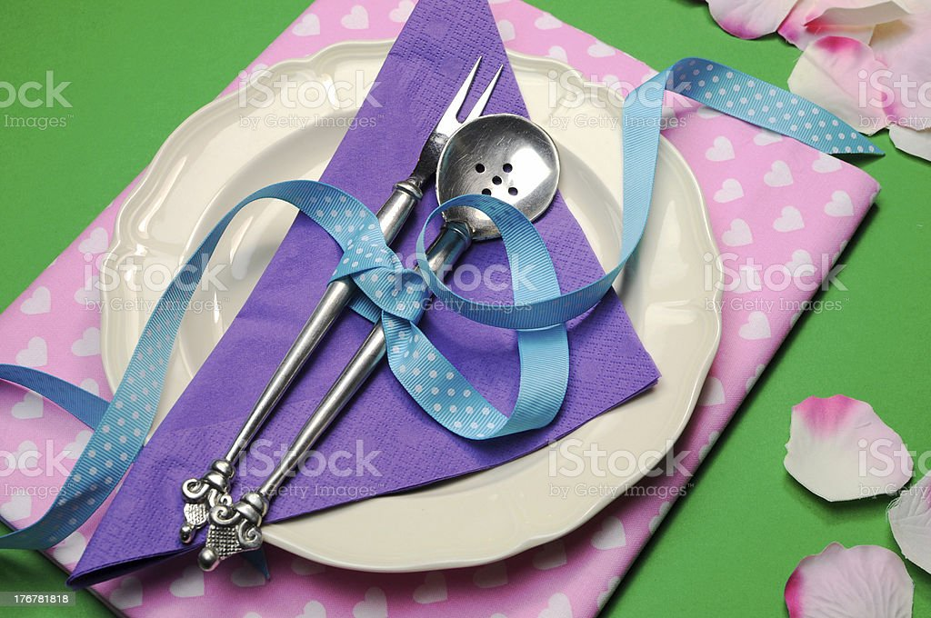 Lunch or dinner table setting in green, purple and pink royalty-free stock photo
