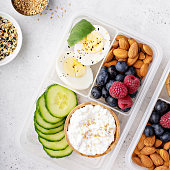 Lunch or snack box with high protein food, cottage cheese, nuts and eggs