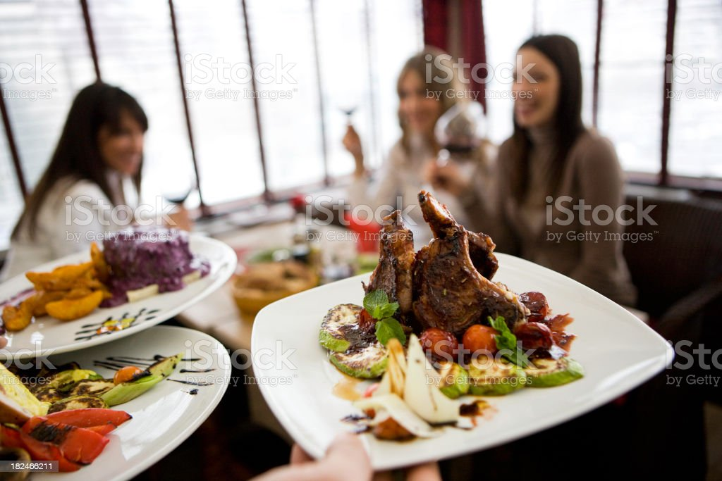 Lunch plates with businesswomen in background royalty-free stock photo