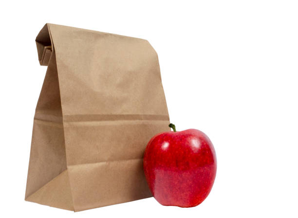 Lunch Sack Folded Over With Red Apple stock photo