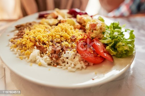 Shot of Brazilian lunch served on plate at restaurant table