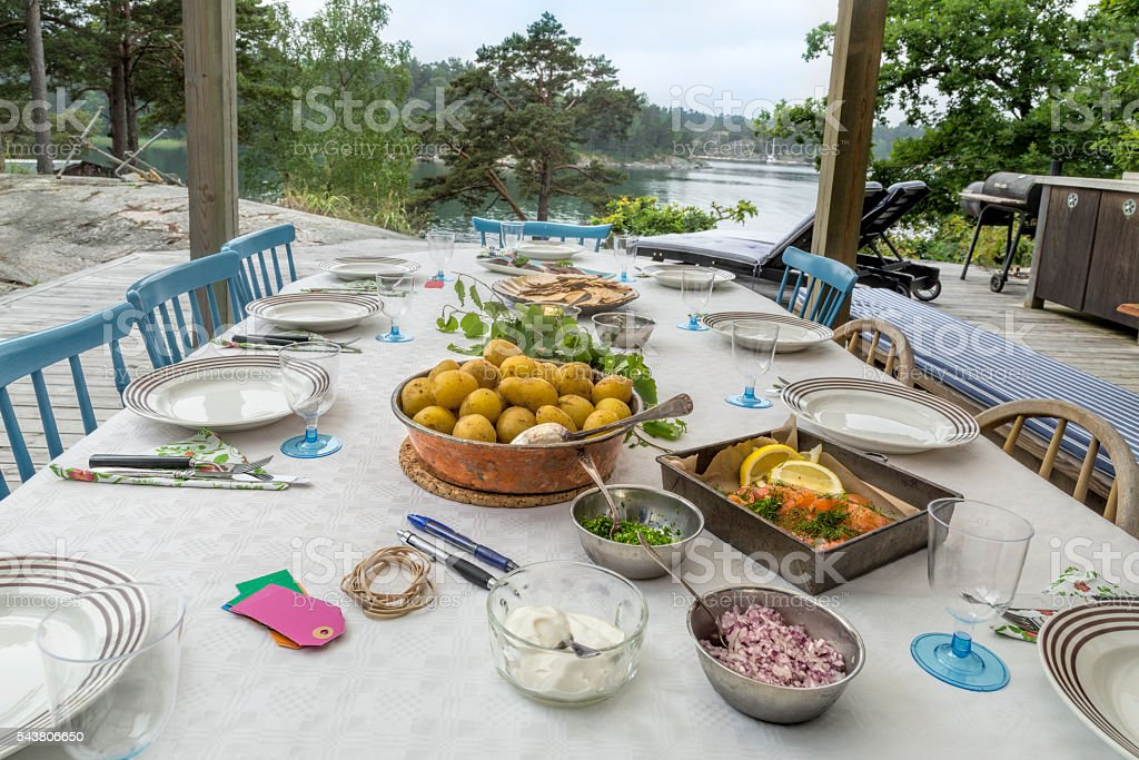 Lunch table by the sea. Swedish midsummer. Stockholm Archipelago. stock photo