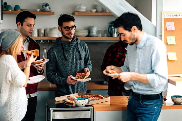 lunch time in the office. - eating technology stock photos and pictures