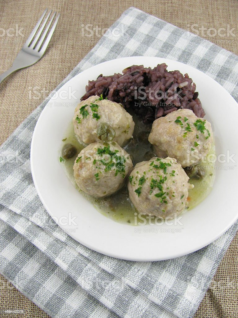 Lunch variation of meatballs, caper sauce and rice stock photo