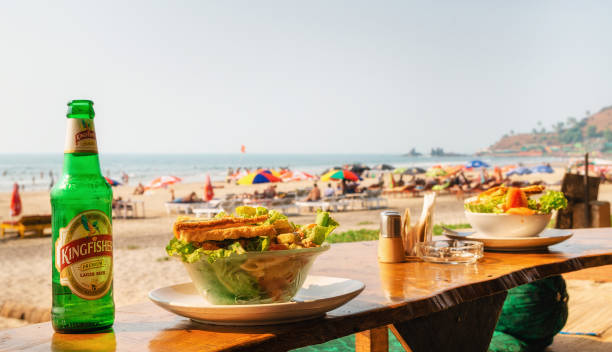 Lunch with salad and beer on Arambol with sea view stock photo