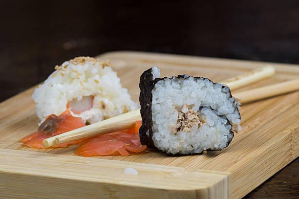lunch with sushi, japanese plate of seafood - lachsroulade stock-fotos und bilder