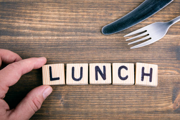 Lunch. Wooden letters on the office desk stock photo