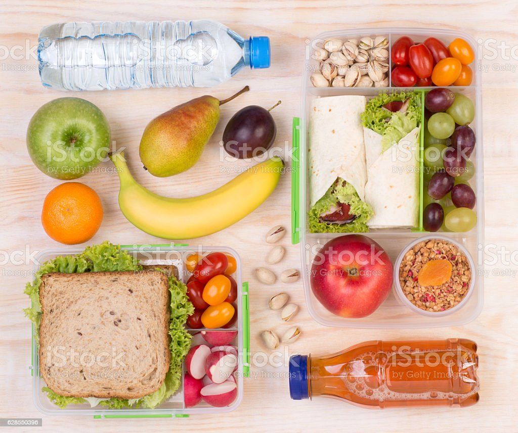Lunchboxes with sandwiches, fruits, vegetables, and drinks – Foto