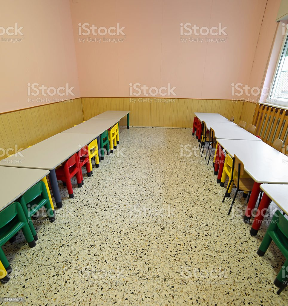 lunchroom with tables and small chairs for children stock photo