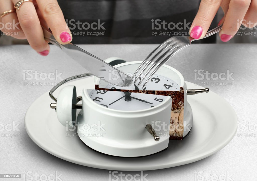 lunchtime concept, hand cut clock stock photo