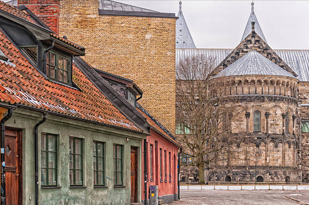 lund cathedral street scene - lund stock photos and pictures