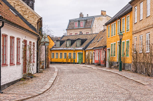 lund cobbled street scene - lund stock photos and pictures
