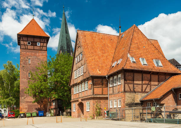 Luneburg, Germany: Historical buildings in the traditional German architecture style. Old house and tower made of red brick on a street of popular touristic town Luneburg - July 2018, Germany: Historical buildings in the traditional German architecture style. Old house and tower made of red brick on a street of popular touristic town lüneburg stock pictures, royalty-free photos & images