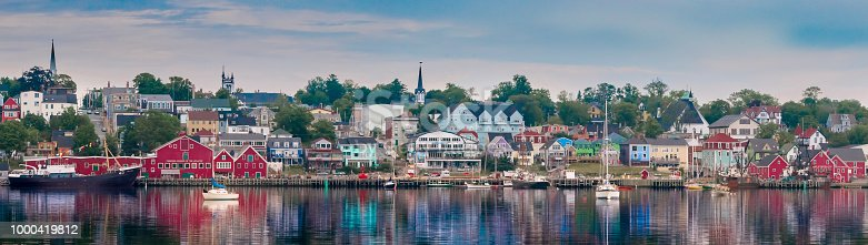 View of Lunenburg, Nova Scotia waterfront with old building on wharfs and colourful buildings