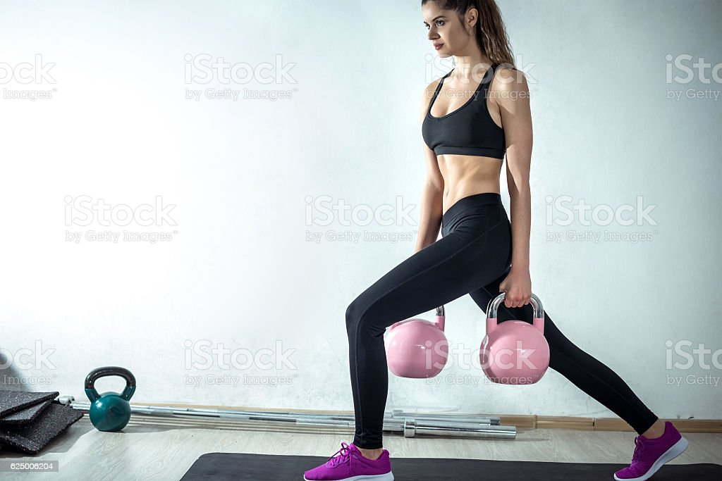 Lunge with rose kettlebell stock photo