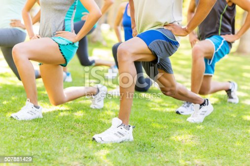 istock Lunges At Bootcamp Workout Class 507881429
