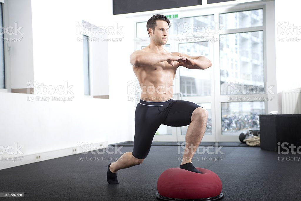 Lunges on Bosu ball stock photo