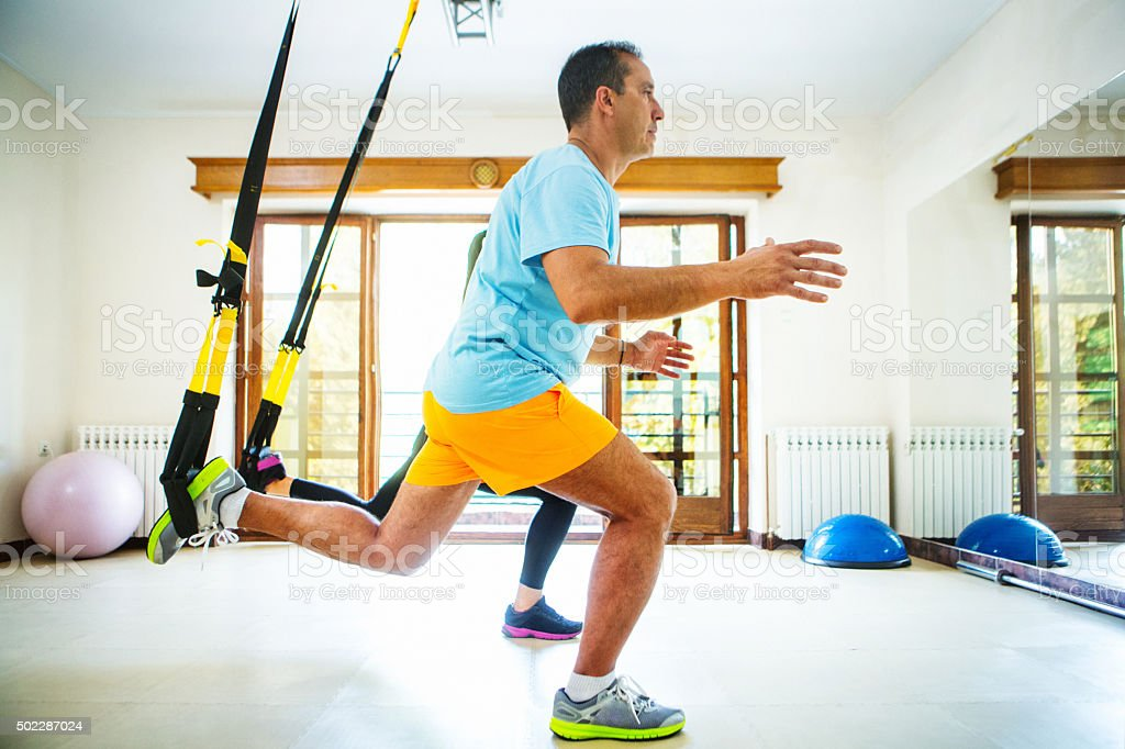 Lunges workout in a gym. stock photo